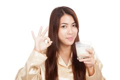 Asian woman drink milk  licking her lip show OK Royalty Free Stock Photography