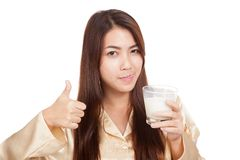 Asian woman drink milk  licking her lip show thumbs up Stock Photo