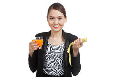 Asian woman drink orange juice hold measuring tape Royalty Free Stock Photography