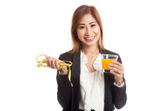Asian woman drink orange juice hold measuring tape Stock Photo