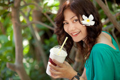 Asian woman drinking Royalty Free Stock Photography