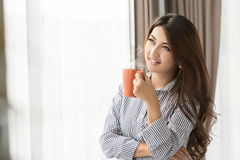 Asian Woman drinking coffee Stock Images