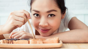 Asian woman drinking coffee stock photo