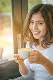 Asian woman drinking coffee Stock Image