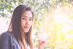 Asian woman drinking coffee. Royalty Free Stock Photos