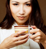 Asian woman drinking coffee or tea Stock Photo