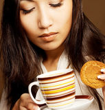 Asian woman drinking coffee or tea Royalty Free Stock Image