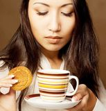 Asian woman drinking coffee or tea Royalty Free Stock Photos