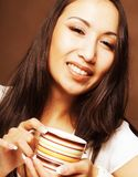 Asian woman drinking coffee or tea. Beautiful asian woman drinking coffee or tea Royalty Free Stock Images