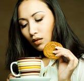 Asian woman drinking coffee or tea. Beautiful asian woman drinking coffee or tea Stock Image