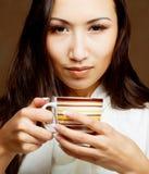 Asian woman drinking coffee or tea. Beautiful asian woman drinking coffee or tea Royalty Free Stock Photos