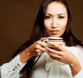 Asian woman drinking coffee or tea. Beautiful asian woman drinking coffee or tea Royalty Free Stock Photo
