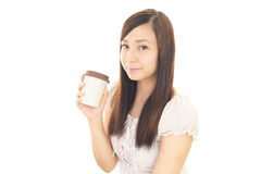 Asian woman drinking coffee Royalty Free Stock Images