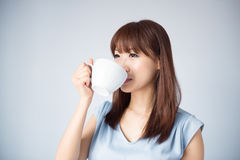 Asian woman drinking a cup of coffee Stock Photography