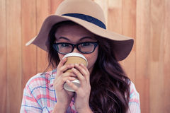 Asian woman drinking by disposable cup Stock Images