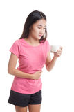 Asian woman drinking a glass of milk got stomachache. Royalty Free Stock Photos