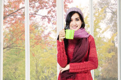 Asian woman drinking hot cappuccino Stock Photography