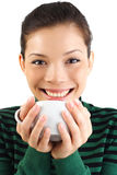 Asian Woman drinking hot drink Stock Images