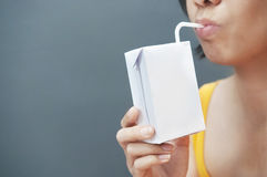Asian woman drinking milk. Royalty Free Stock Photo