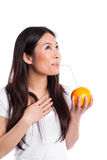 Asian woman drinking orange juice Stock Image