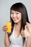 Asian woman drinking orange juice Stock Photos