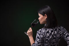 Asian woman drinking red wine Stock Images