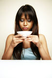 Asian woman drinking soup Stock Photo