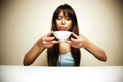 Asian woman drinking soup Stock Photography