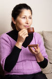 Asian woman drinking tea Royalty Free Stock Image