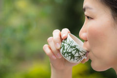 Asian woman drinking tea Royalty Free Stock Photos