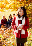 Asian woman drinking a warm drink Stock Images