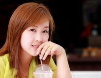 Asian woman drinking water Stock Photo