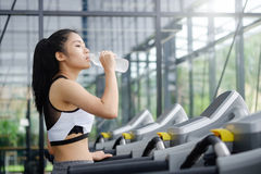 Asian woman drinking water on wellness. Royalty Free Stock Photo
