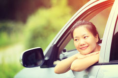 Asian woman driver driving a car Stock Images