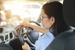 Asian woman driving car with  feeling happy.  Royalty Free Stock Photos