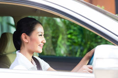 Asian woman driving car Royalty Free Stock Image