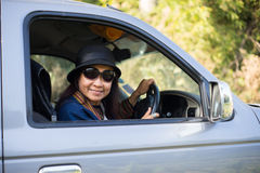 Asian woman driving car royalty free stock images