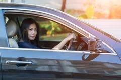 Asian woman driving her car. Asian woman driving her car Royalty Free Stock Image
