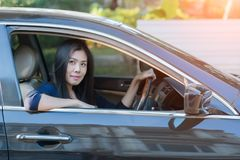 Asian woman driving her car. Asian woman driving her car Royalty Free Stock Photos
