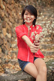 Asian woman and dry flowers in her hand Royalty Free Stock Photos