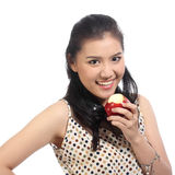 Asian woman eat red apple Stock Photo