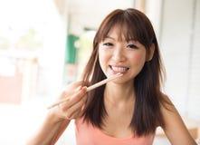 Asian woman eating Stock Photos