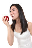Asian Woman Eating Apple Royalty Free Stock Image