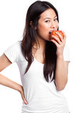 Asian woman eating apple Royalty Free Stock Images