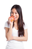 Asian woman eating apple Stock Images