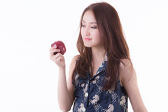 Asian woman eating an apple. royalty free stock photography