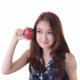 Asian woman eating an apple. Royalty Free Stock Images