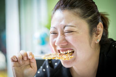 Asian woman eating banana roast Royalty Free Stock Images