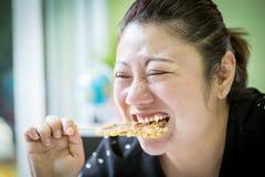 Asian woman eating banana roast Royalty Free Stock Images