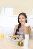 Asian woman eating at cafe Stock Photo